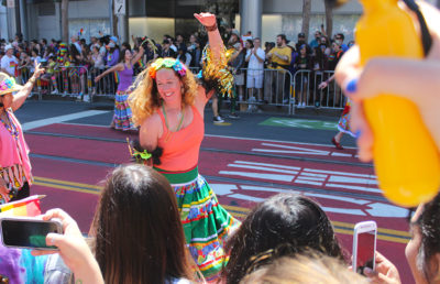 Parade dancer responds to the crowd's cheers with a smile