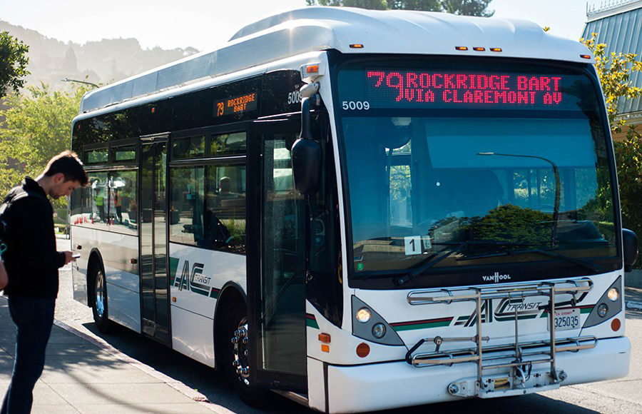 The 79 AC Transit bus stops and opens its doors for passengers.