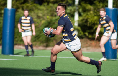Berkeley Rugby player runs with ball in his hands.