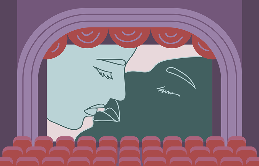 Two people kissing on screen in movie theater