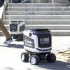 A kiwi bot rolling through Sproul Plaza