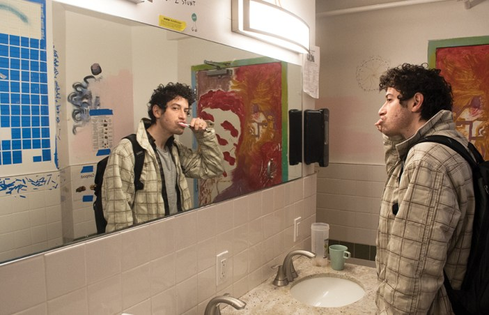 Garfinkle brushes his teeth at his friend's home in Berkeley in the morning. DAVÍD RODRÍGUEZ/SENIOR STAFF