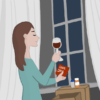 """A woman holding a glass of wine and a card that says """"love you"""""""