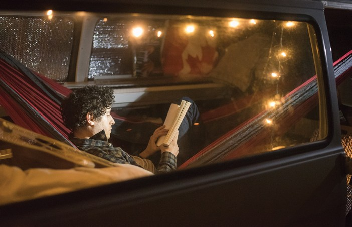 Garfinle finishes off his night by turning on his string lights and settling into his hammock with a book. DAVÍD RODRÍGUEZ/SENIOR STAFF