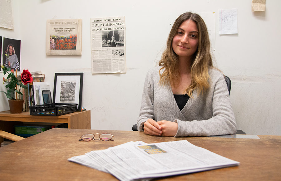 Soofie Motamedi, the recently elected 2019-20 editor in chief of The Daily Californian, smiles while sitting in her new office.