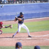 Mens baseball player prepares to swing at the ball