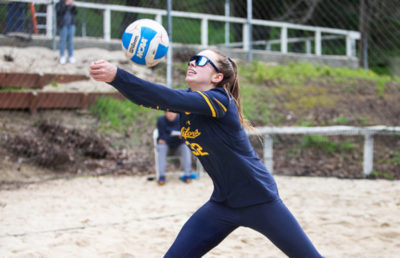 A volleyball player bumps the ball.