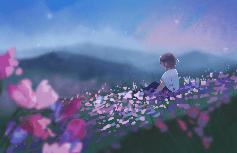 Person sitting on a hill with flowers