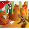 Bears sitting in front of a TV with superheros