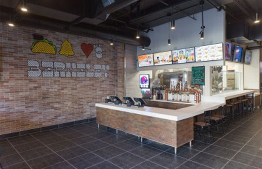 The inside of a fast food restaurant is empty.