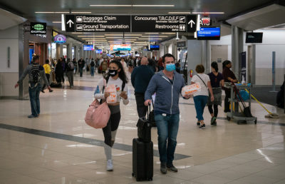 Flyers at Hartsfield-Jackson Atlanta International Airport wearing facemasks on March 6th, 2020 as the COVID-19 coronavirus spreads throughout the United States.