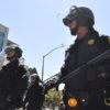 Berkeley police stand in protective gear during duty