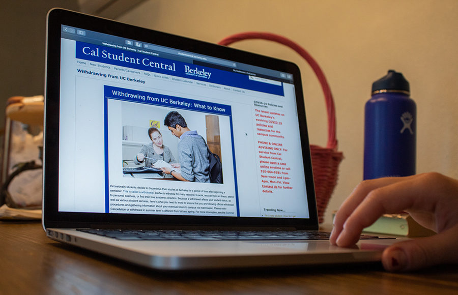 A student is withdrawing from UC Berkeley on a laptop.