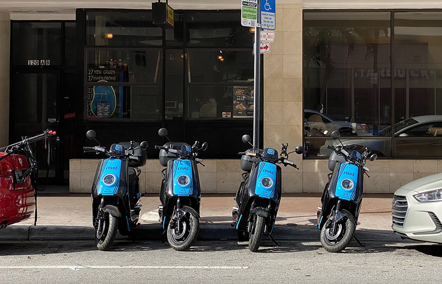 Photo of blue moped scooters