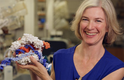 Photo of Jennifer Doudna posing with CRISPR model