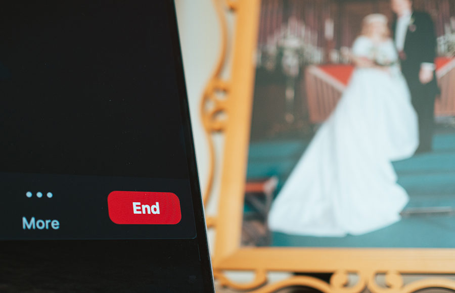 Photo of a zoom window on a computer in front of a wedding photo