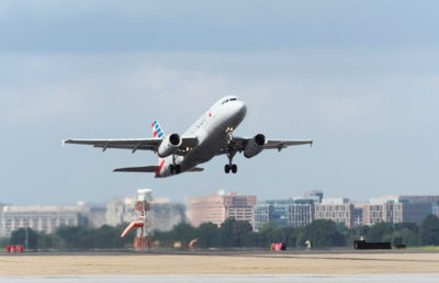 Photo of an airplane taking off at an airport