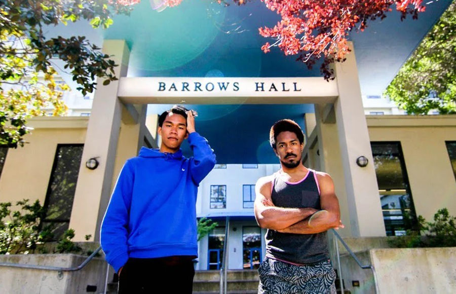 Photo of Bradley Afroilan in front of Barrows Hall