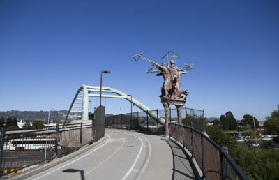Photo of Big People statues on the I-80 pedestrian bridge