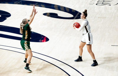 Photo of Dalayah Daniels holding the ball in front of a USF defender