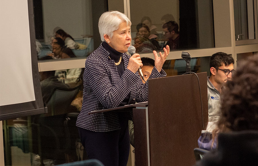 Photo of Chancellor Carol Christ speaking at a meeting