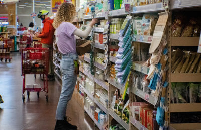Photo of a Trader Joe's employee stocking a shelf