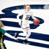 Photo of Archer Olson of Cal Women's Basketball dribbling