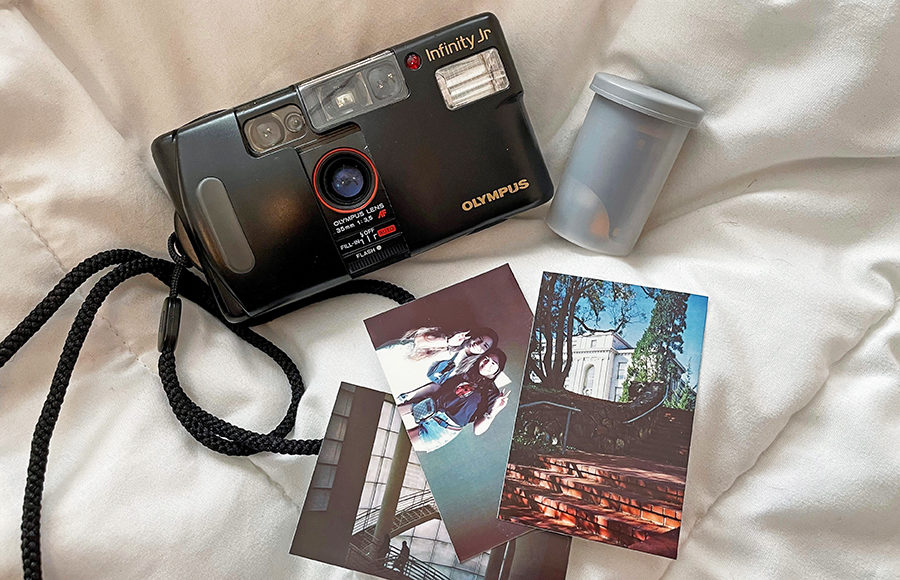 Photo of a Film Camera and Photos
