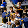 Photo of Cal Men's Basketball team in a huddle