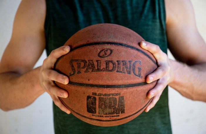 Photo of someone holding a basketball