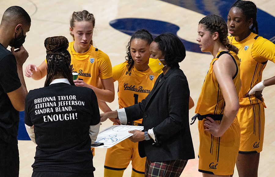Photo of Cal Women's Basketball in a huddle