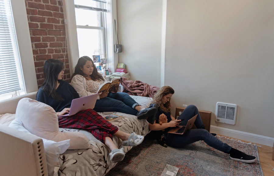Photo of friends studying in a living room