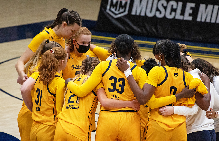 Photo of Cal Women's Basketball team in a huddle