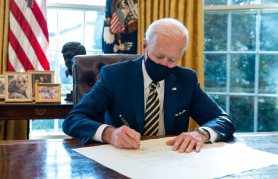 Photo of Joe Biden signing a bill