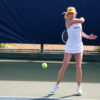 Photo of Cal Women's Tennis player hitting the tennis ball