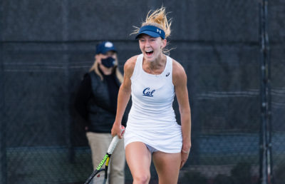 Photo of Julia Rosenqvist of Cal Women's Tennis screaming in celebration at the Pac-12 championships
