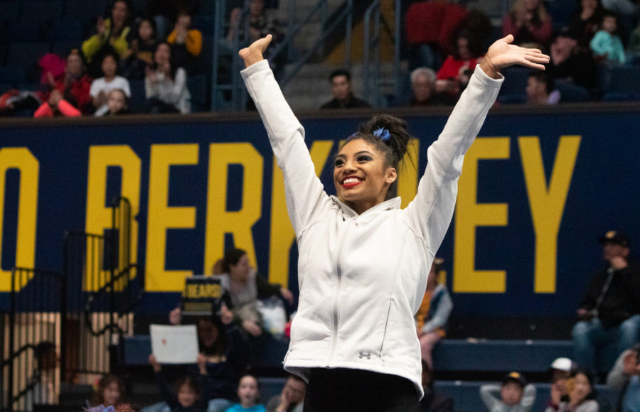 Photo of Kyana George waving at the crowd