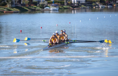 photo of the Cal women's rowing team competing