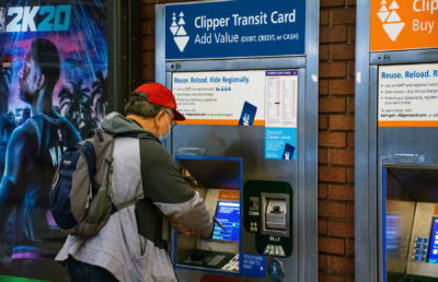 photo of a man reloading a clipper transit card