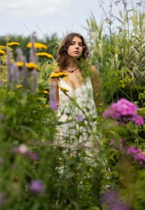 photo of a girl in a field of flowers