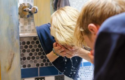 Photo of someone washing their face