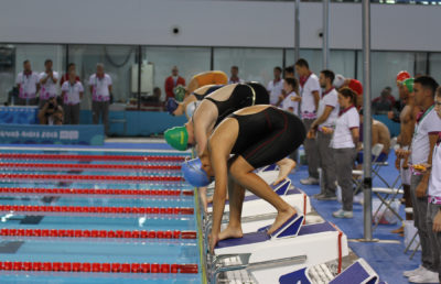 photo of swimmers on the starting blocks