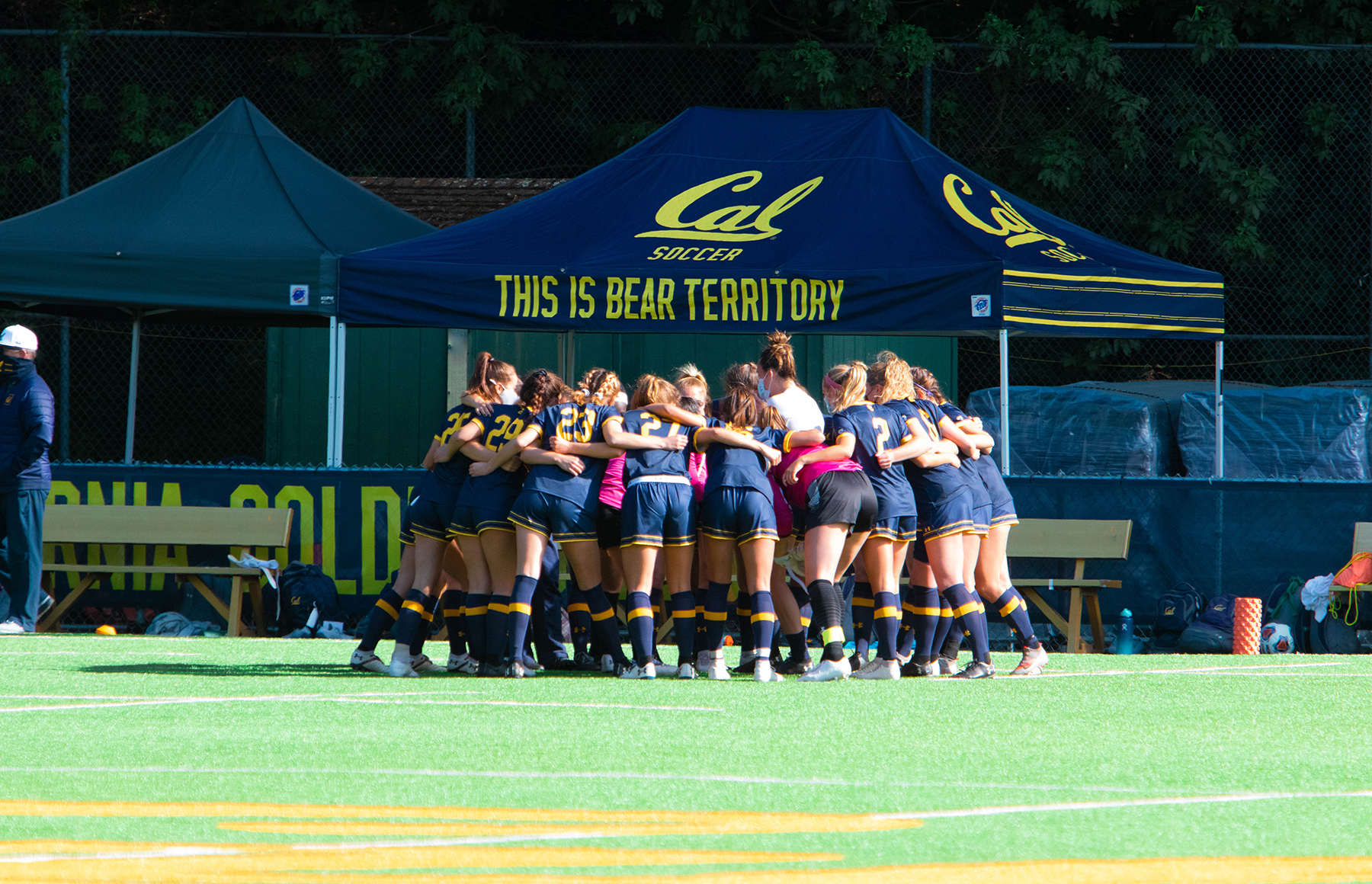 photo of the women's soccer team in a huddle
