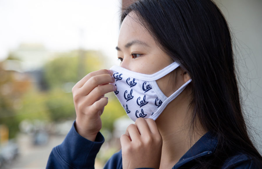 photo of a girl putting on a face mask