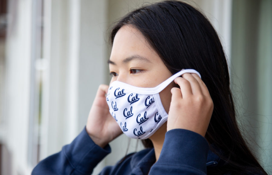 photo of a girl putting on a mask
