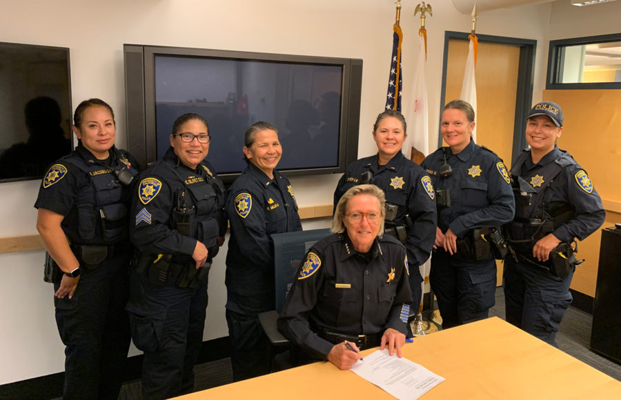 photo of women cops around a table