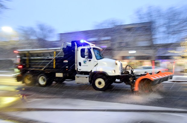 A Longmont snow plow clears snow ...