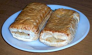 Two sausage rolls on a plate