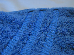 Close-up photo of part of a bath towel. (Photo credit: Wikipedia)
