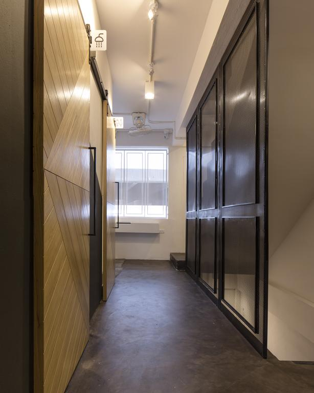 Bed One Block Hostel Design - showers